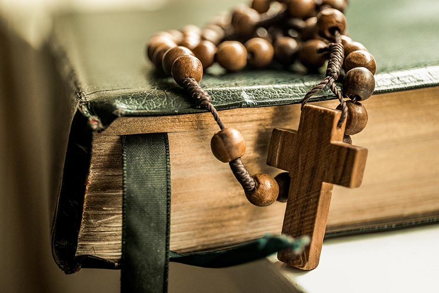 rosary and book